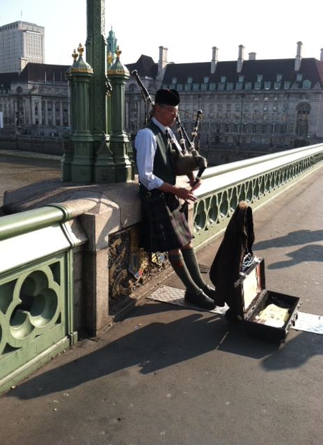 England - Bagpiper on Bridge
