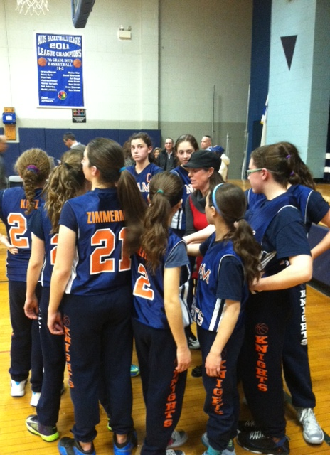 Kayla with Coach in Huddle